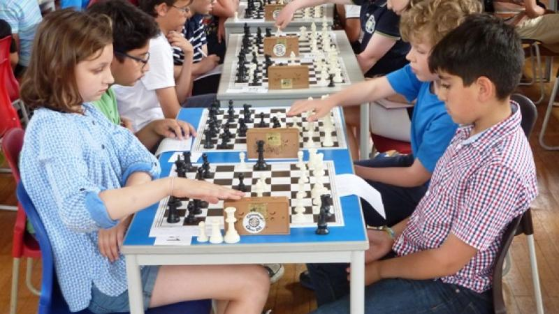 Lizzie Robson makes a move in her game with Adel Youssef at Saffron Walden